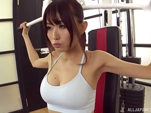 Lodge sporty Asian babe pounded doggy style on a yoga ball vanguard gym
