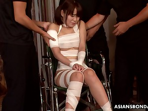Tied up slender Japanese nympho Nene Masaki is mouthfucked by three dudes