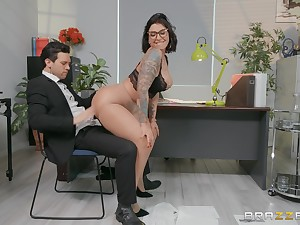 Chap-fallen secretary Devon Lee enjoys sex with her partner in crime in her office