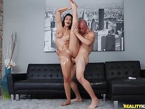 Bald guy pleased Katana Kombat with hardcore sex on black sofa