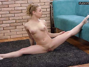 Lovely natty flexible girl Olesya Kisbeka flashes tits during flexy time