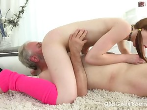 Lusty pigtailed chick round closely-knit confidential sucks senior man's cock in 69 pose